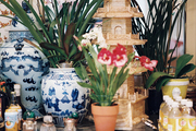 Blue-and-white ginger jars on a marble-topped console