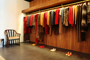 Jenni Kayne clothing hangs on a rack in her West Hollywood shop