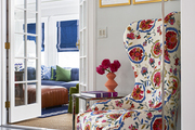 A wing chair upholstered in a botanical print embroidered fabric