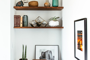 Wooden shelves filled with decorative objects.