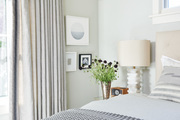 A look at the bedside of a guest room.