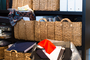 Baskets and binders serving as office organizers