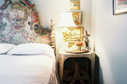 A hand-painted Italian headboard in a gray bedroom