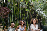 Textile designer Bridgid Coulter and her daughters, Tai and Imani, picnic in their backyard on Kantha blankets