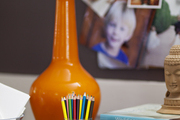An orange lamp surrounded by office essentials