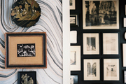 Global art pieces hung on marbleized paper in a bathroom