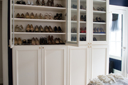 Glass-paned cabinets with a variety of shoes.