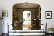 Curved wrought-iron handrails leading to an arched doorway in a Georgia home