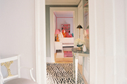 A zebra-print rug in a hallway with gray walls