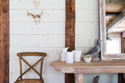 Pine plank walls complement a rustic sideboard