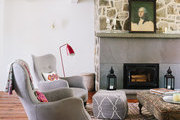 A pair of cozy armchairs in an eclectic living room