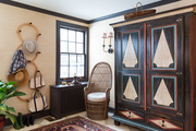 A 19th-century Latvian armoire, from California's Petersen Antiques, anchors the entry foyer.