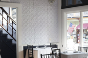 A crystal chandelier and pressed-tin walls at Tallulah on Thames