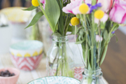 A detail of a tablescape with pastel bowls.
