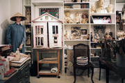 Bookcases arranged with inspirational items and mementos