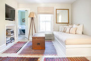 Cozy living area with bench seating and colorful area rugs.