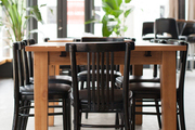 Wood table and chairs in a Savannah restaurant's dining room