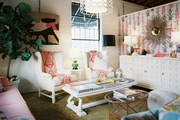 A pair of white wingback chairs in an eclectic living space