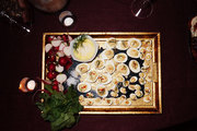 Rich hors d'oeuvre are served on a gold tray