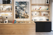 Open shelving displaying bags and surfboard fins