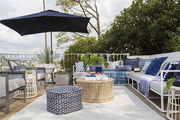 Outdoor seating on a backyard deck.