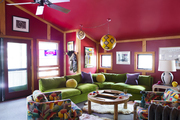 A game room with colorful chairs and sofas