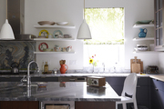 A modern country kitchen with marble countertops