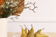 Pears are arranged on a table.