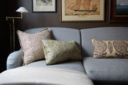 A chaise lounge and throw pillows are part of the decor in Emily Beare's apartment.