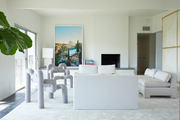 Modern, architectural pieces in an all-white living room.