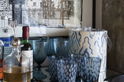 Small bar with patterned cups and party essentials.
