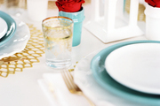 An outdoor dinner table set with blue and white dishes