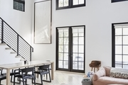 A living room area of a Los Angeles home with gorgeous steel-framed windows.