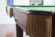 The corner pocket of a billiard table