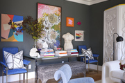 Maximalist library space with blue decor and modern art.