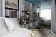 A mirrored closet in an art-filled bedroom