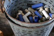 Pile of cut dowels in stacked vintage buckets.