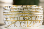 A stack of gold patterned china