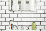 A bathroom with white subway tile.