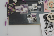A magnetic black board with photos.