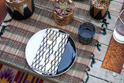Geometric and tribal prints atop an outdoor dining table