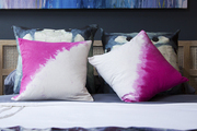 Throw pillows atop a contemporary bed