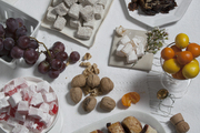 An assortment of desserts on white table linens.