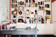White built-in shelving and a gray desk in an office space