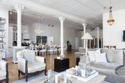 Vintage furniture and multiple pillars in this large open room.
