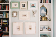 Framed art between two built-in bookcases