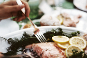 Oven-poached salmon at an outdoor dinner party