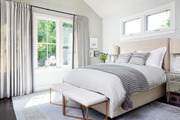 A contemporary bedroom with beige and gray colors.