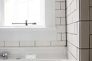 White subway tile with black grout.
