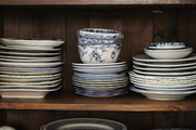 A wooden hutch holds a collection of blue and white china